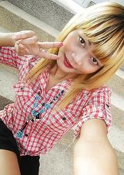 Adorable blonde Ladyboy Wa takes self shot pics