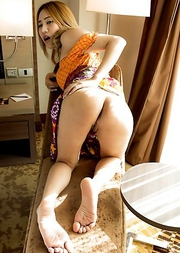 Natty is bent over doggystyle with her sundress above her hips and pussy-flesh fully exposed.