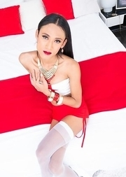 Ladyboy Creamy is wearing a skimpy white and red two-piece.