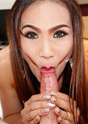 Lusty Khawn is waiting for cock on the couch wearing a two-piece sheer orange outfit. I can see her ladyboy cock and asshole ready for fucking under h
